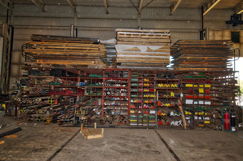 A photo showcasing the inventory and selection of metal located on one side of the warehouse at Hubert Sabourin Inc.